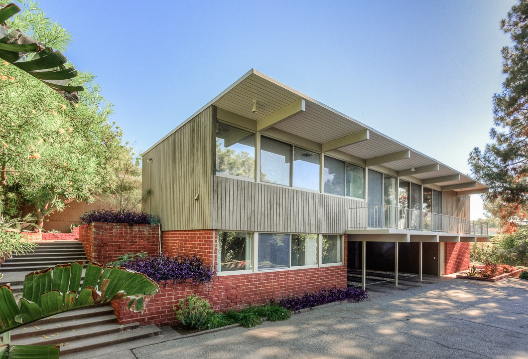 Publisher and art collector Benedikt Taschen and his wife, Lauren purchase a Modernist on Summit Drive